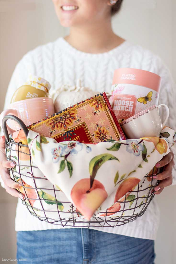 Learn how to create this beautiful tea basket. Need some Gift Basket Ideas for Mother's Day? Or for that matter any friend who loves tea parties? Well, this post teaches all the things to consider when putting together a great gift basket from the container to the perfect items from HomeGoods! #giftbasketideas #giftbaskets #gifts #HomeGoods #shopbaskets #teabasket