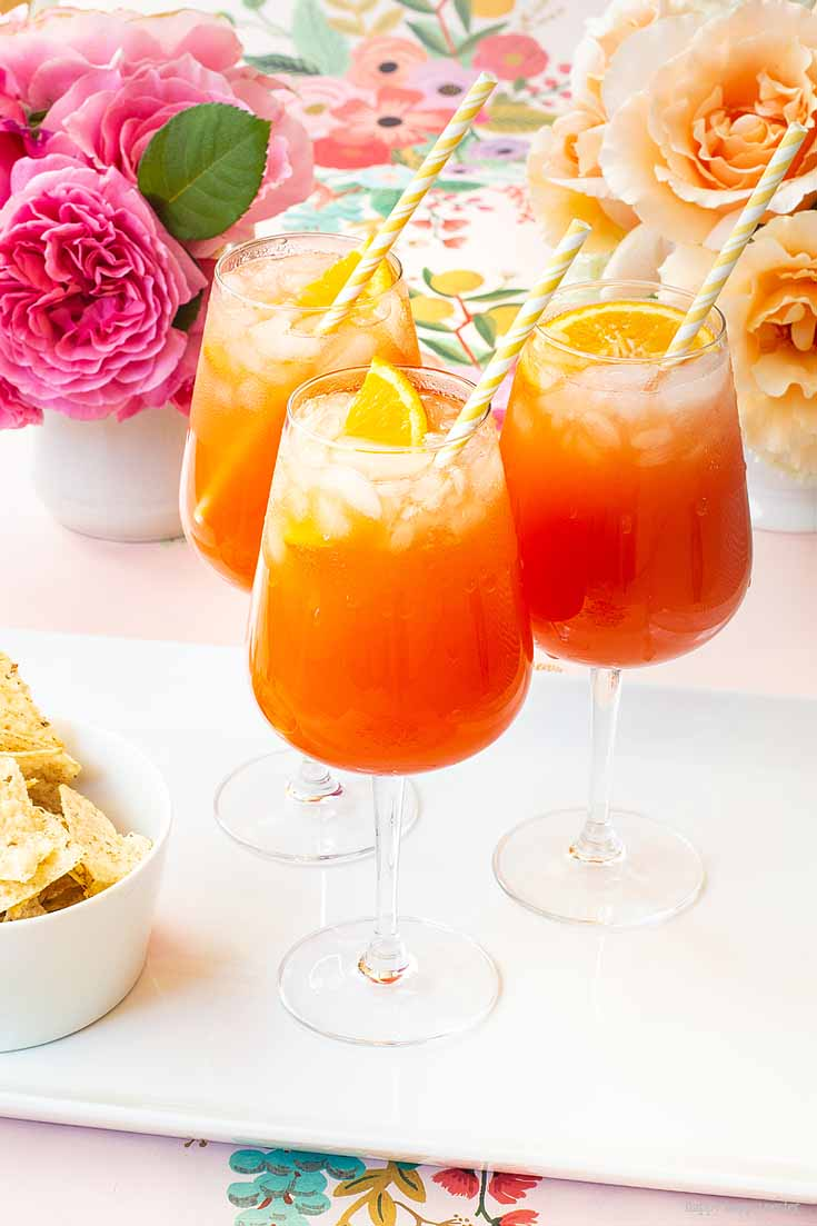 This Simple Punch Recipe for Mother's Day. Make this easy drink for special occasions or any party. Make it with rum or as a non-alcoholic drink. This Planters Punch drink has pineapple, orange juice, and grenadine in the ingredients. #drinks #cocktails #punch #weddings #weddingparty #rum #planterpunch #mocktails
