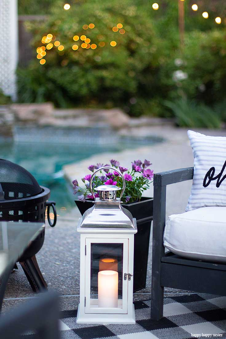 We love our outdoor fire pit for summer smores. In this post learn Learn How to Create a Cozy Outdoor Living Space in 9 easy tips. This DIY to summer decorating is essential. #summerdecor #outdoorlivingspaces #entertaining