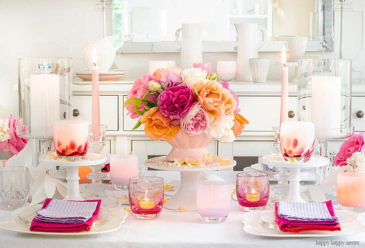 a full length table setting with flowers and candles
