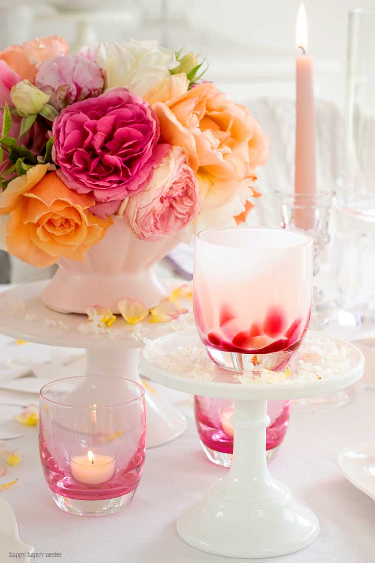 Roses on a white table with candles