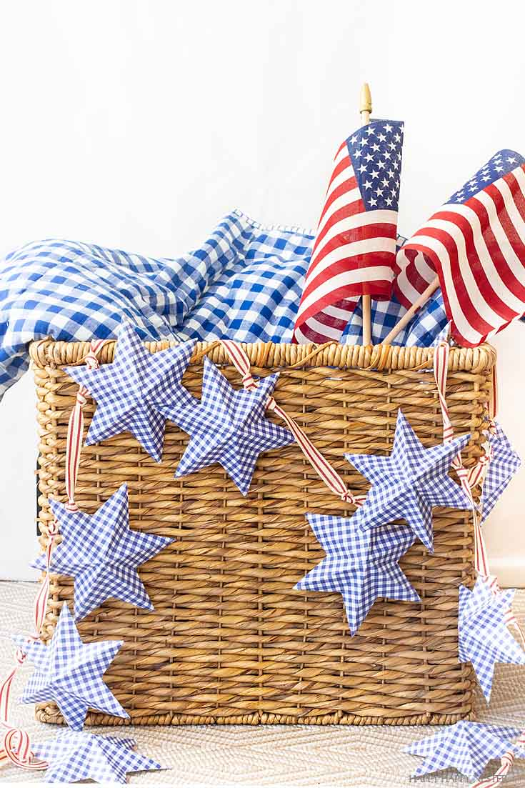 This DIY Paper Stars for 4th of July Garland is an easy and inexpensive holiday banner. Get the free printable, cut and fold and string it on a cute ribbon. The blog post has an easy to follow video tutorial #4thofjuly #garland #crafts #papercrafts #summerproject #diy #paper