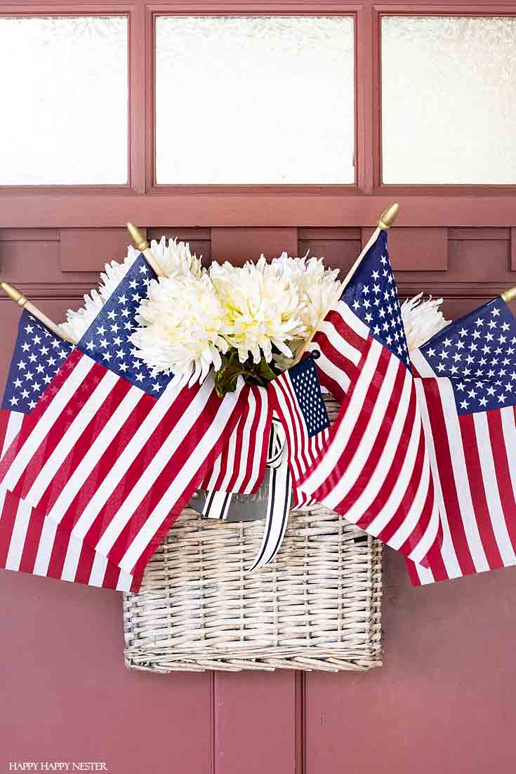 This festive flag front door is perfect for the 4th of July! Take a little tour of our holiday porch. #summerdecor #4thofjuly #holidaydecor