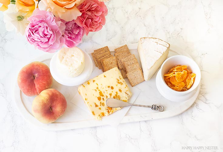 Learn how to create this cheese charcuterie cheese board. It only takes a few minutes, and yet it is a delicious combination of fruit and cheeses. #appetizers #parties #entertaining #charcuterieboards #charcuterie #recipes
