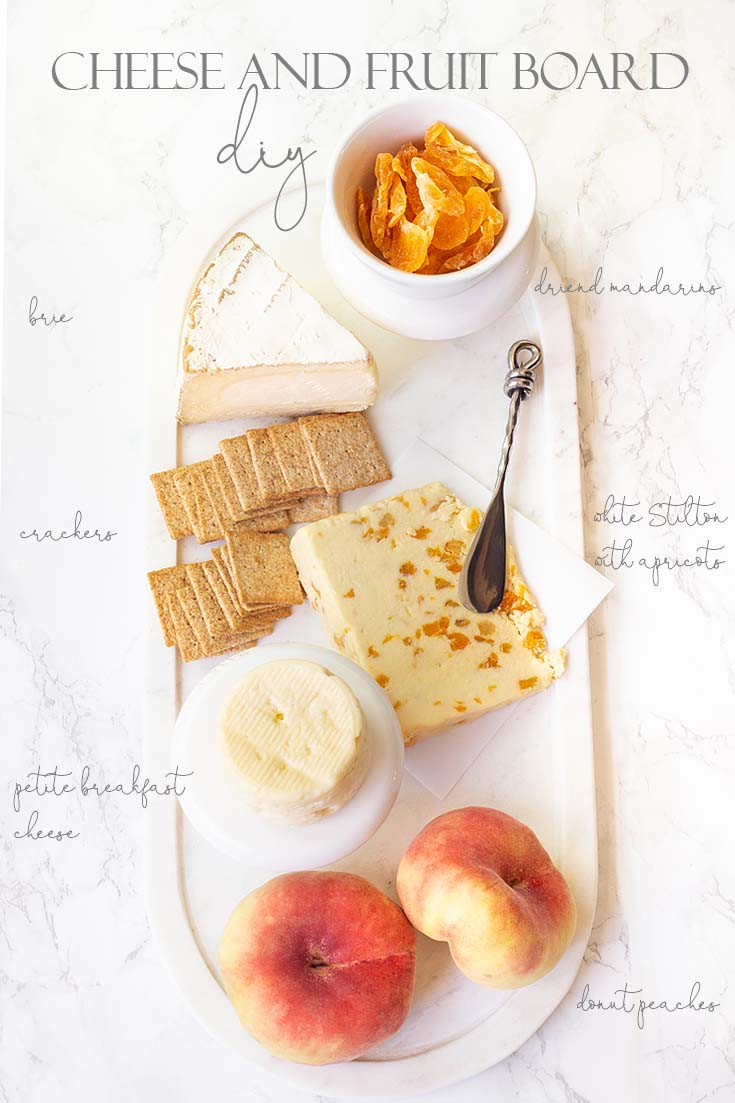 Use just some simple elements like three chesses and a variety of fruit create a yummy board. #appetizers #entertaining #cheeseboards #parties #recipes #chacuterieboards