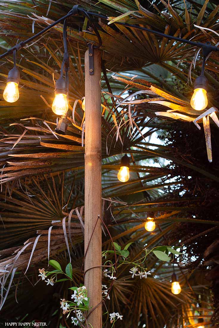 Learn how to Hang Outdoor String LIghts in cement supports in this very thorough tutorial. This technique and DIY is a solid solution. Also, the light poles are easy to install and are quite stable. #DIY #outdoorlights #patios #gardenprojects