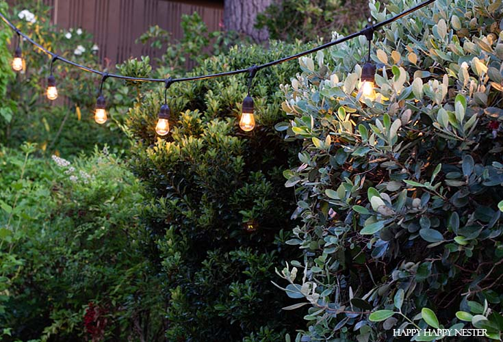 This is a thorough tutorial on how to hand the outdoor vintage Edison lights in a cement hole. #vintageoutdoorlights #patio #outdoorlights