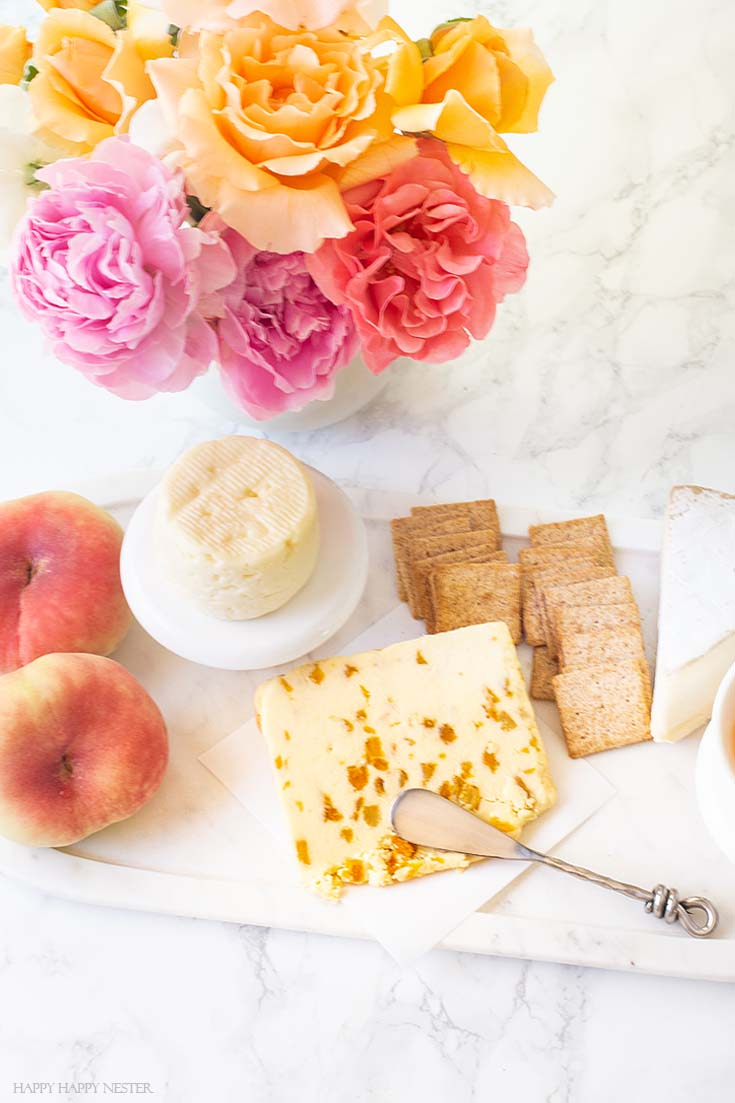 Learn how to create this yummy appetizer board. It only takes a few minutes, and yet it is a delicious combination of fruit and cheeses. #appetizers #parties #entertaining #charcuterieboards #charcuterie #recipes