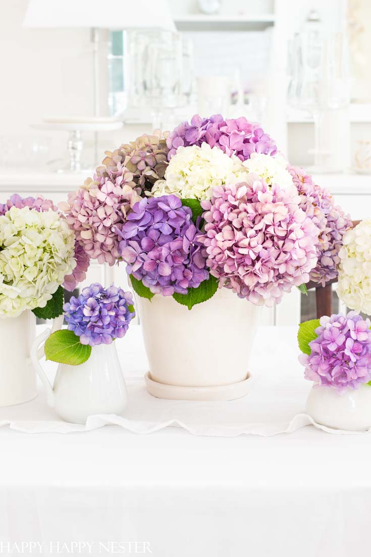 This 5 Minute Summer Centerpiece is so simple and quick and if you use the hydrangeas from your garden and this floral bouquet will costs pennies to create.