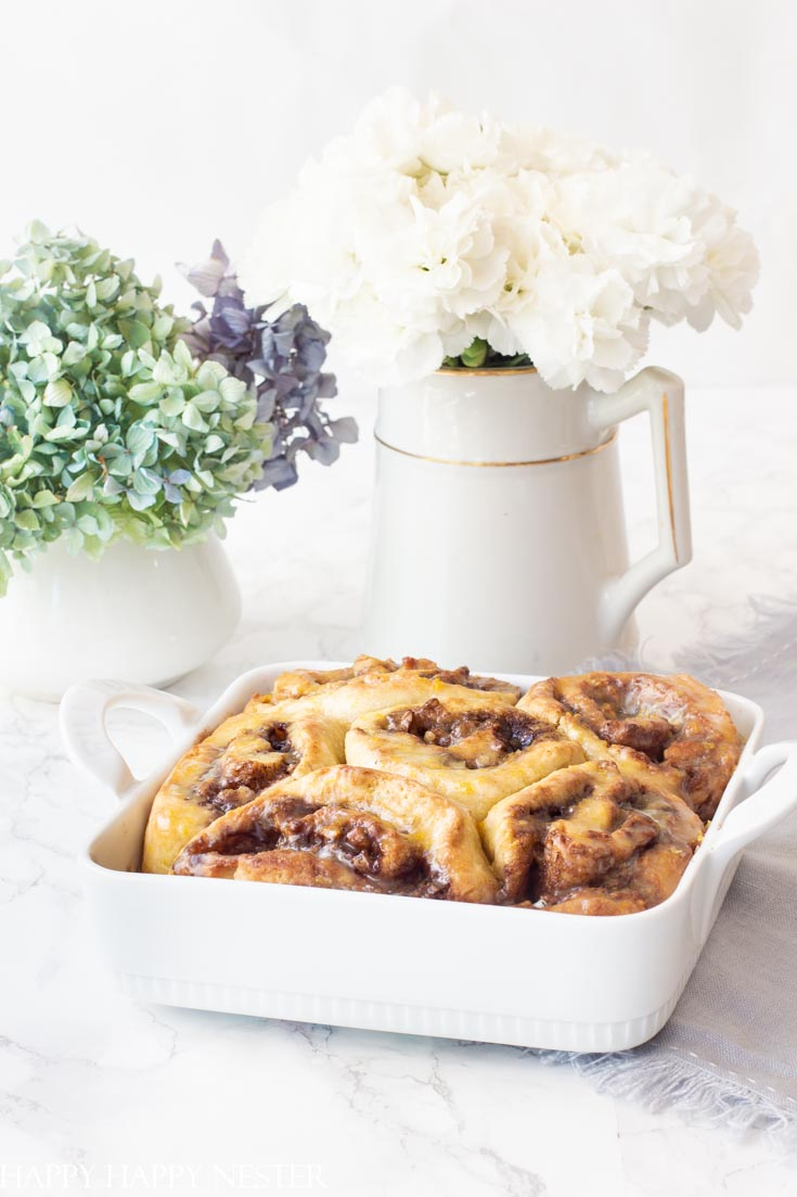 These wonderful Homemade Orange Sweet Rolls are so easy to make and they require no yeast. This recipe is inspired by Joanna Gaines Magnolia Table Cookbook. Take a look at all these amazing recipes! #magnoliatablerecipes #fixerupper #recipes #magnoliarecipes #joannagaines
