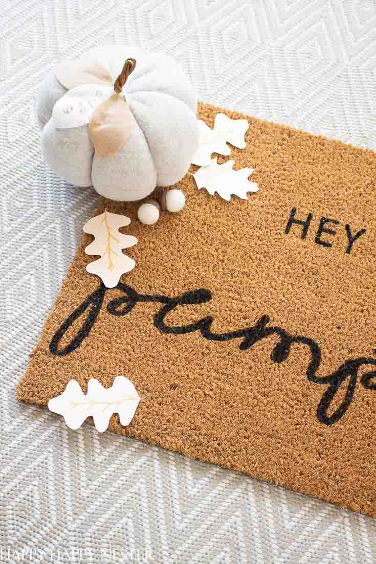 For this Fall doormat project, you need a blank mat, paint, and a free printable stencil design. Once you have your stencil, it only takes a few minutes to complete your cute fall doormat! #stencils #doormat #doormattutorial