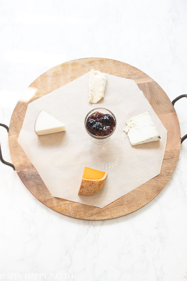 Need some Easy Appetizer Ideas for a Party, then you'll want to view this step by step tutorial. It shows how to build a fruit, cheese charcuterie board all the elements you need. These amazing boards with delicious gourmet foods will impress your guests! Get started on this great appetizer and you'll create a ton of wonderful party foods. #appetizers #easyappetizers #charcuterieboard