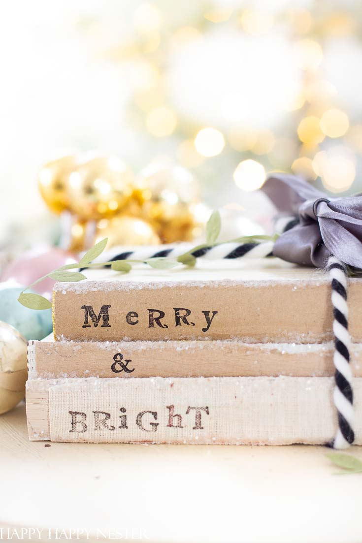 If you are looking for an easy Christmas Craft project than make sure to create these adorable stamped books. Use any old books you may have lying around the house and bring them back to life with this craft! #crafts #holidaycrafts #christmascrafts #stamping #bookstamping