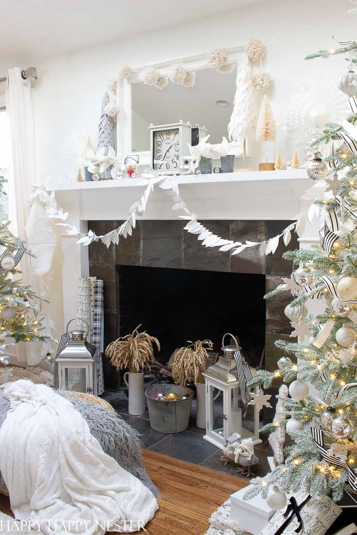 This post is all about Mantel Decor For Christmas. 41 bloggers are sharing their mantels for the holidays. It is a great collection of winter mantels. #decor #holidaydecor #christmasmantel #howtodecorateamantel #manteldecor