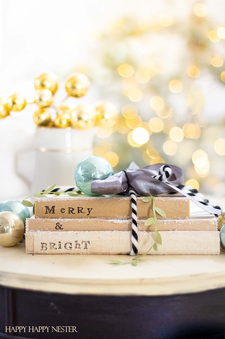 If you are looking for an easy Christmas Craft, then check out these cute stamped books. Gather some old books and alphabet stamps and make these easy project. #crafts #christmascrafts #stampproject
