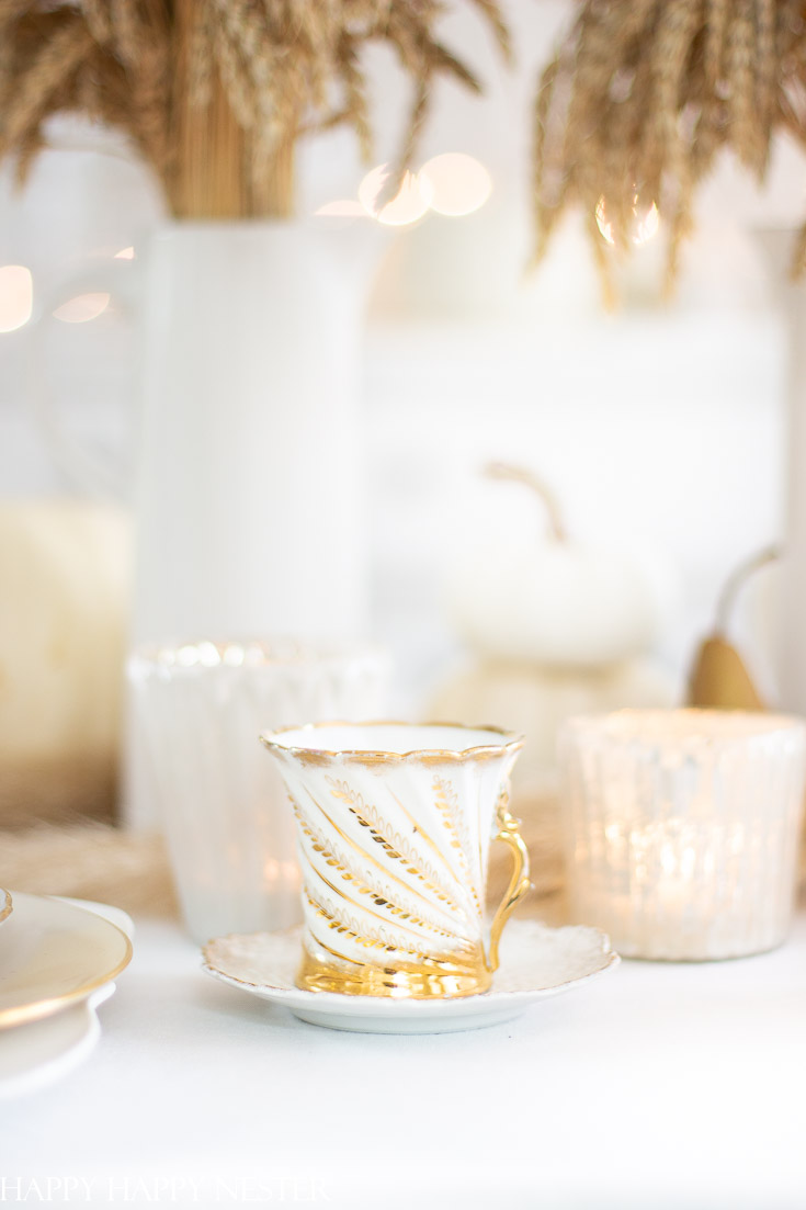 Pull out your table decor when setting your Fall Table. Here are a thriftshop teacup and white crystal candle votives. shop your home for elements. #tabledecor #tablesetting #thanksgiving #wheat