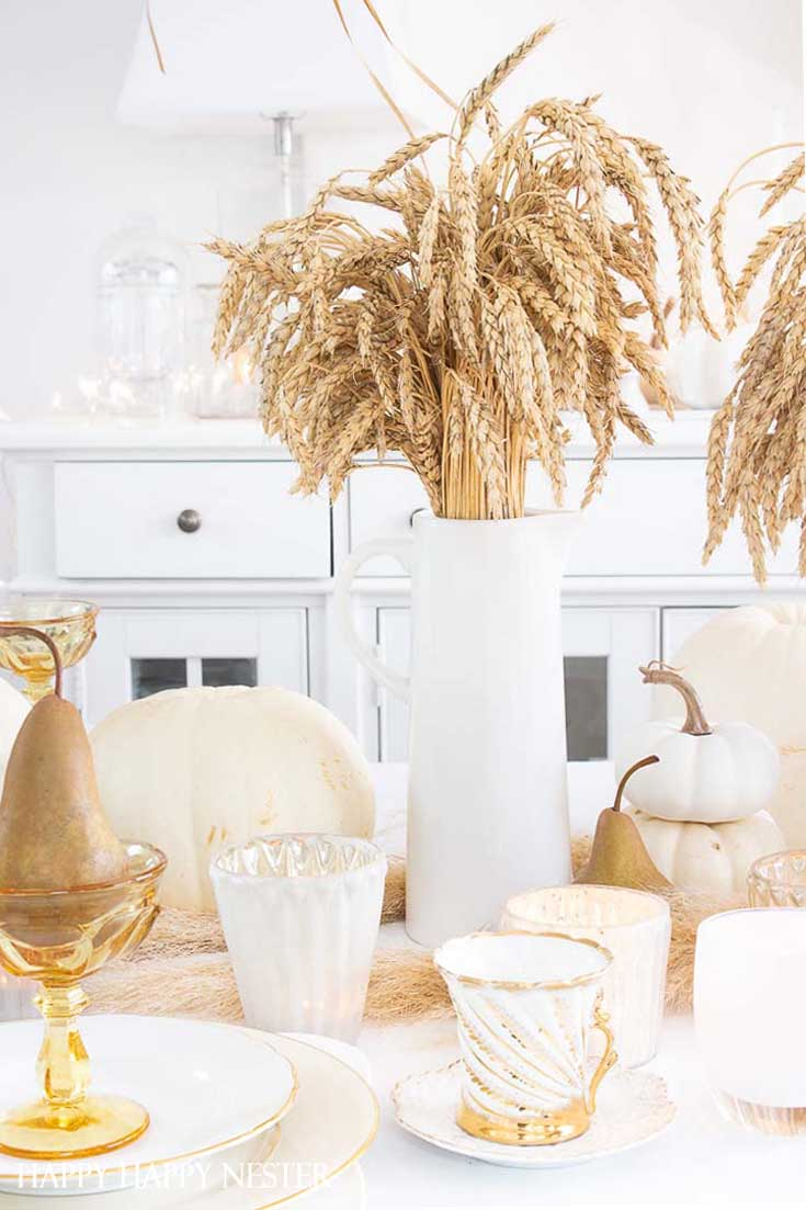 Here is a Thanksgiving Table Setting Made Easy. Find out how the 7 elements to set a Thanksgiving table step by step. This table has all-natural elements and wheat makes a beautiful fall centerpiece for a table. #thanksgiving #thanksgivingtable #tabledecor #createathanksgivingtable #tablesetting