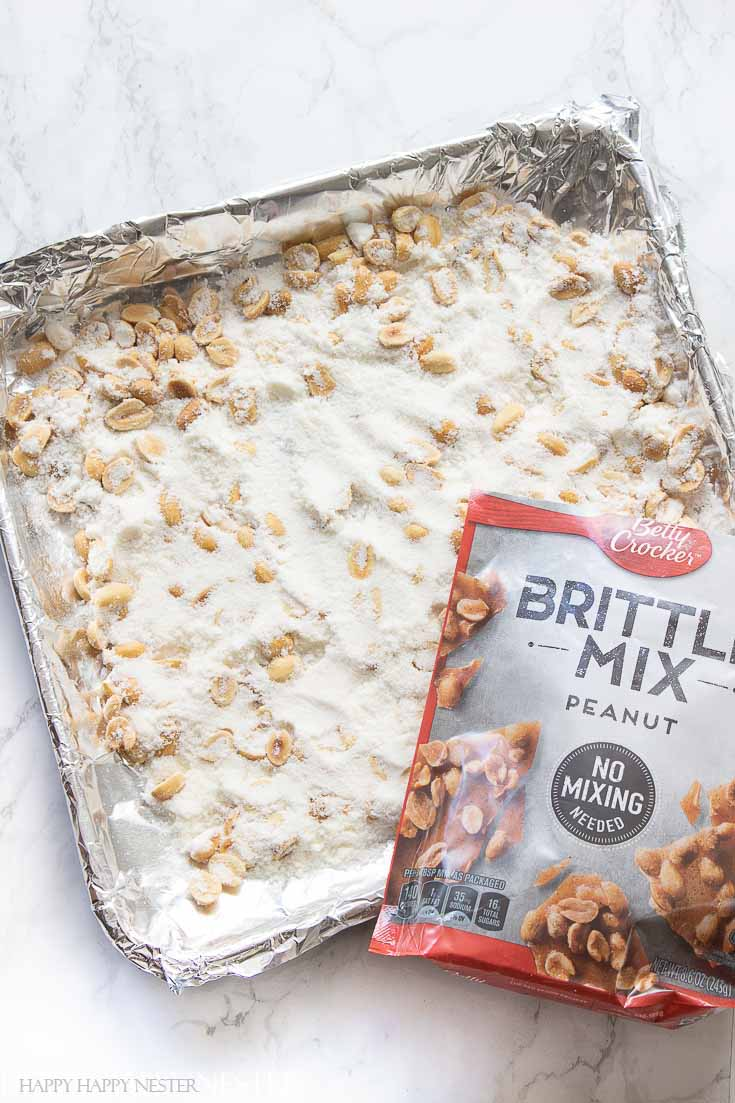 No mixing for this peanut brittle recipe. Just place in a greased pan and bake. And the rest is magic! It is like the traditional peanut brittle you know and love! #recipe #peanutbrittle #thebestpeanutbrittle