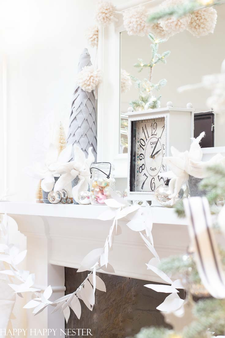 Need some Mantel Decor For Christmas? 41 bloggers are sharing their beautiful mantels for the holidays. It is a fabulous collection of winter mantels. #decor #holidaydecor #christmasmantel #howtodecorateamantel #manteldecor