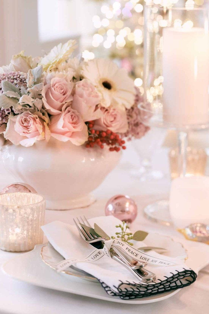 Setting a Christmas table is easy when you have a few decor elements. This holiday home night tour shows off a vintage pink romantic table. Visit this post for some Christmas inspiration! #holidaytable #christmastable