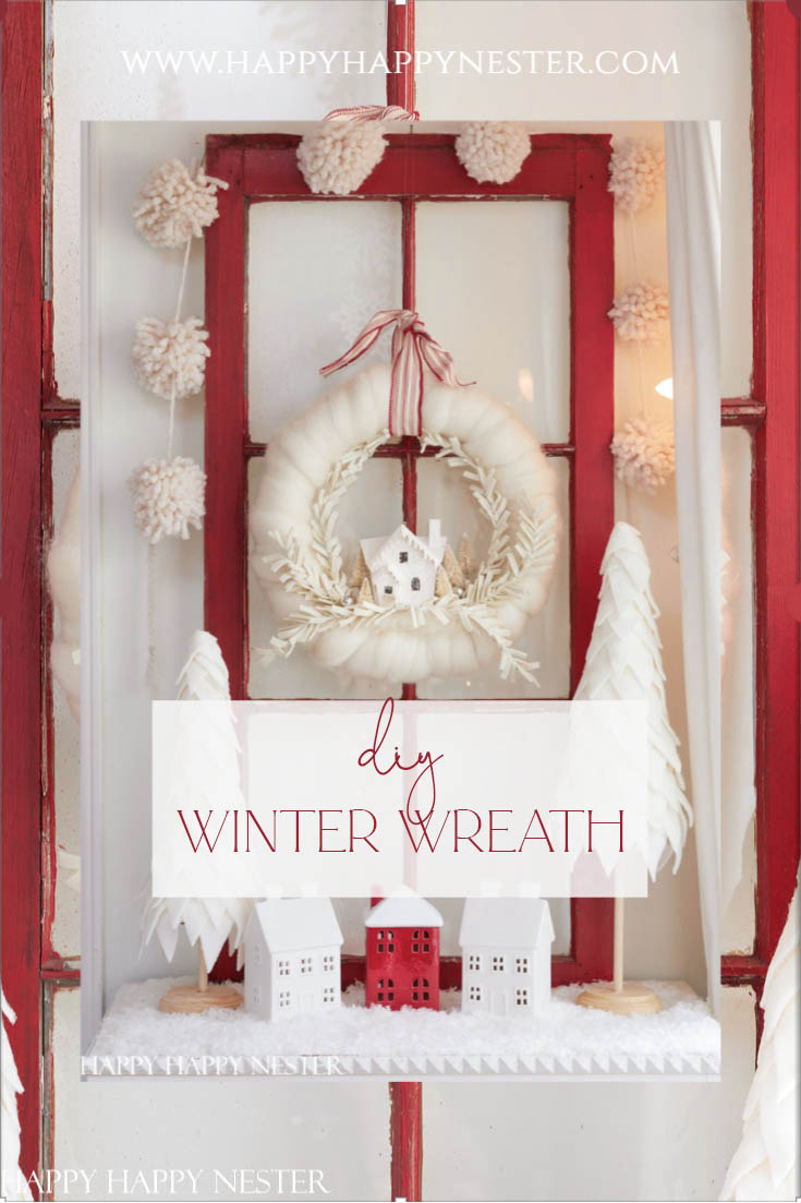 You're going to enjoy this DIY Winter Wreath Ideas Roundup. This post includes many styles and colors of wreaths, from pine to ornaments. Learn how to make this cute putz house holiday wreath.