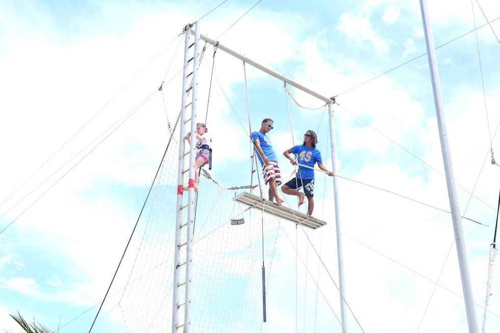 Meghan climbing the trapeze at Club Med Cancun Yucatan