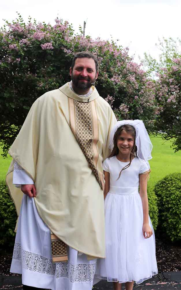 Meghan with Father Brian First communion weekend