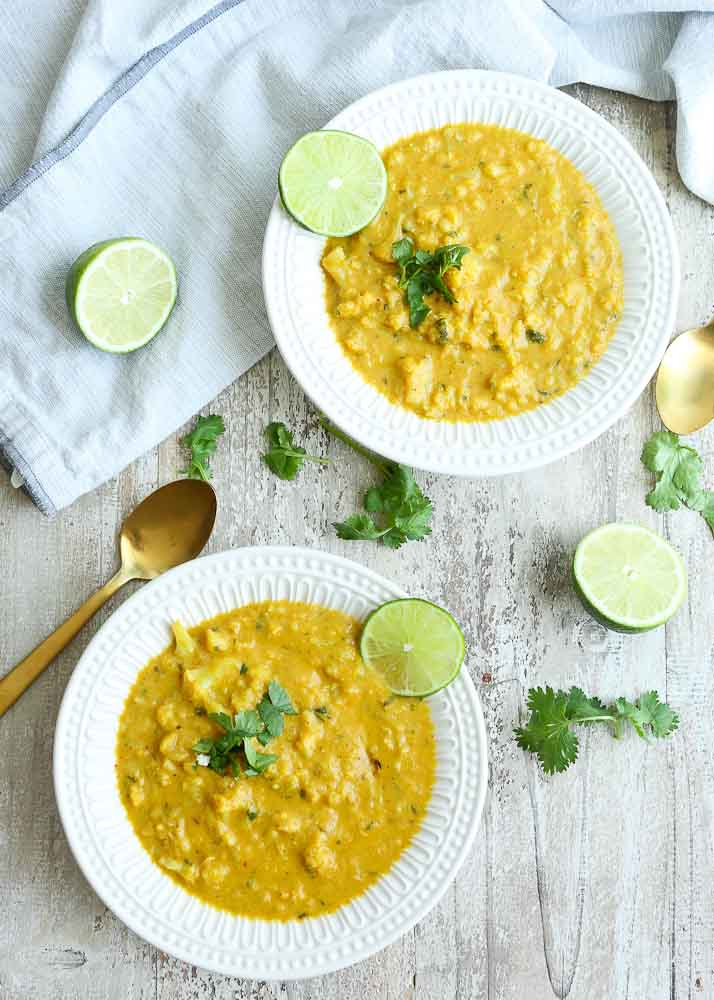 Two bowls of Cauliflower Soup with Coconut, Turmeric, and Lime recipe