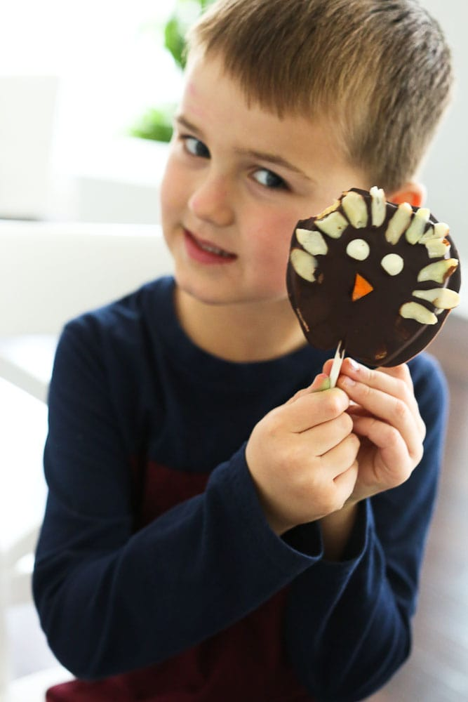 Luke holding his Chocolate Covered Apple Turkey Pops