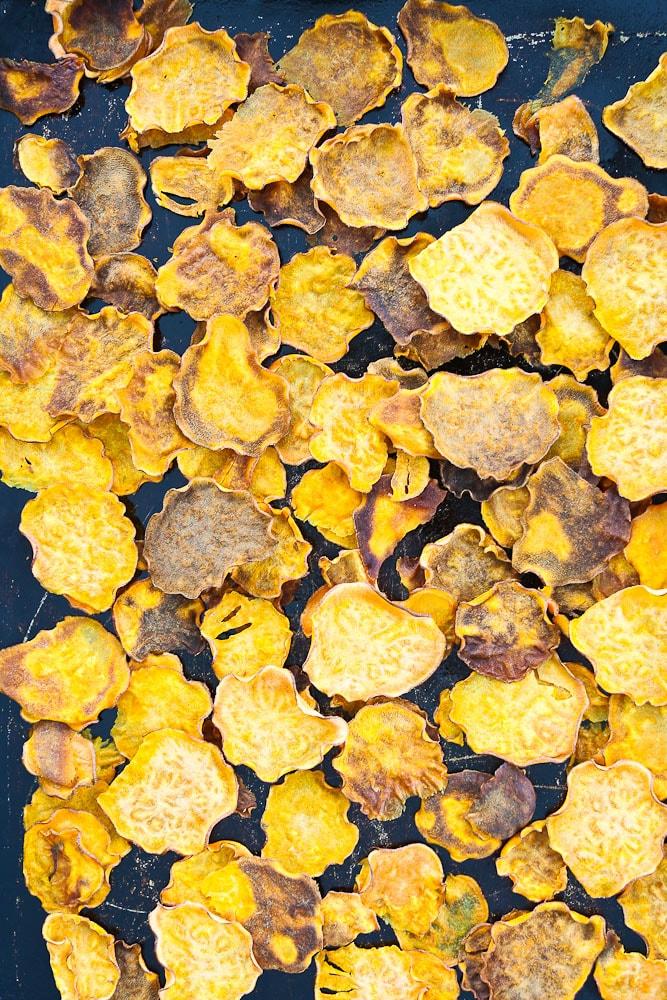 Sweet Potato Nachos Recipe the sweet potato chips on a baking sheet