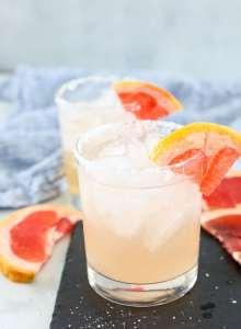 Grapefruit Margarita in two margarita glasses with grapefruit garnish