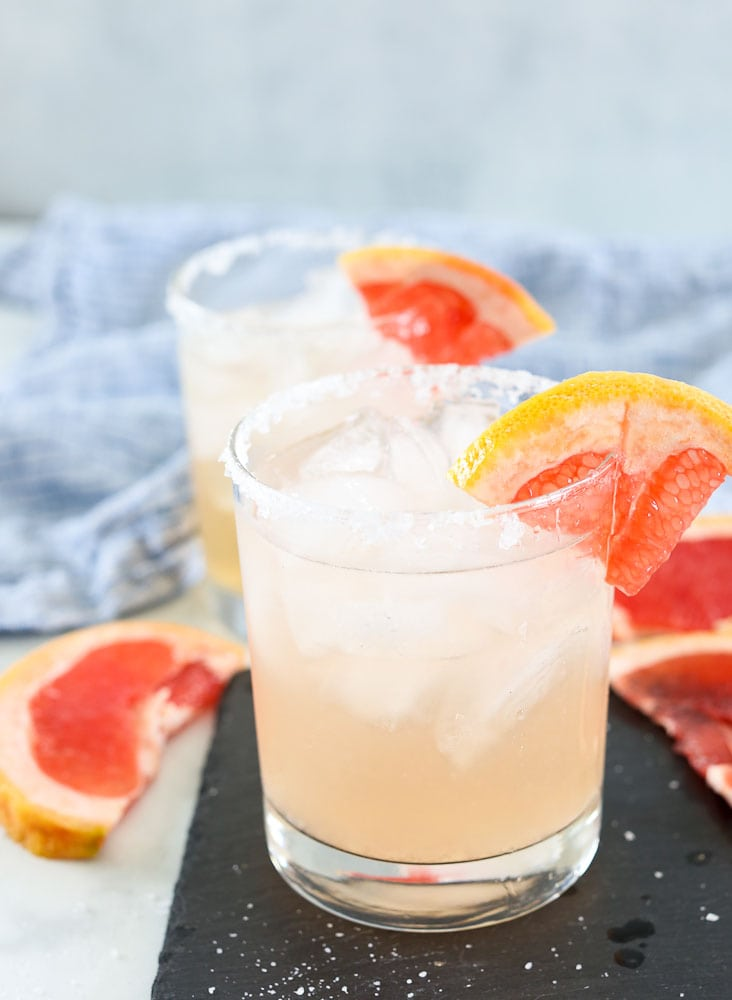 Grapefruit Margarita in two margarita glasses with grapefruit garnish