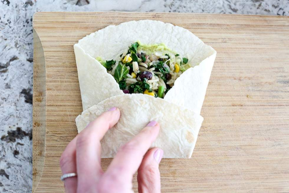 Hummus Veggie Wrap- folding the second side