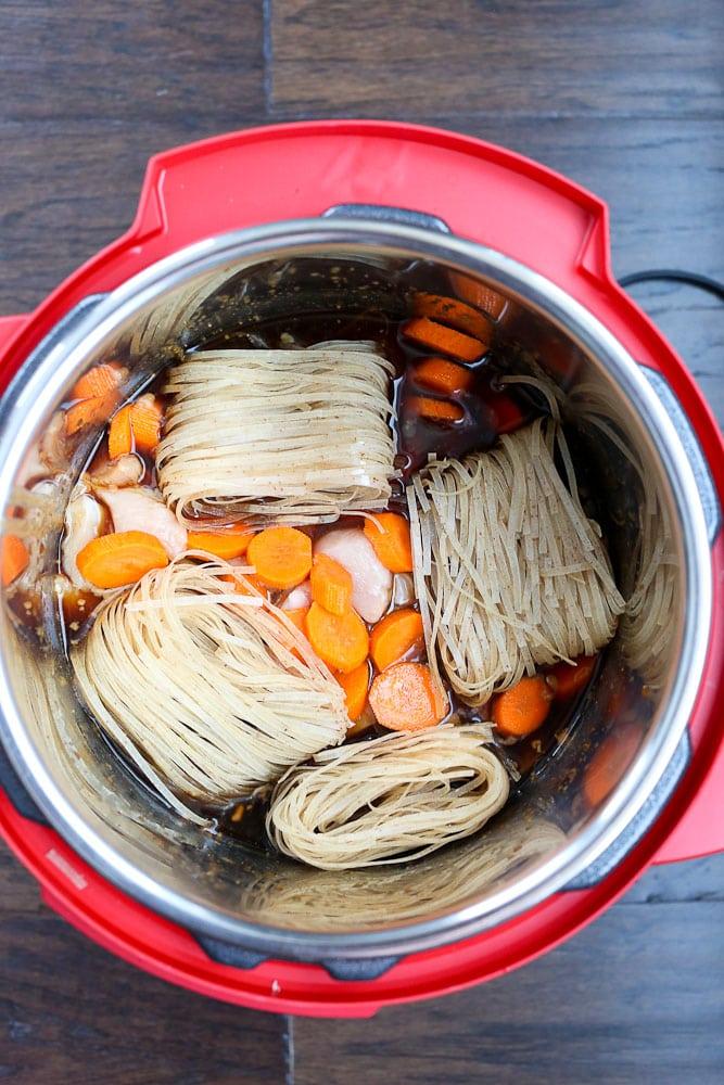 Instant Pot Asian Noodle Bowls dump and set ingredients in the Instant Pot pressure cooker