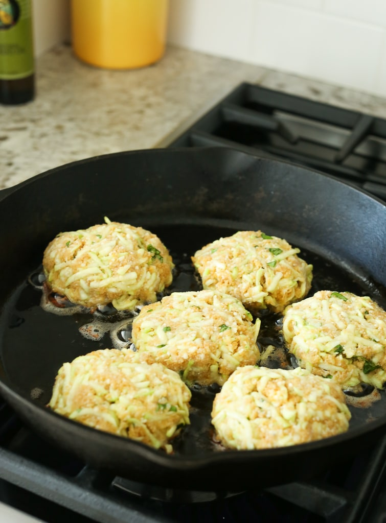 Zucchini Cakes cooking in the cast iron skillet