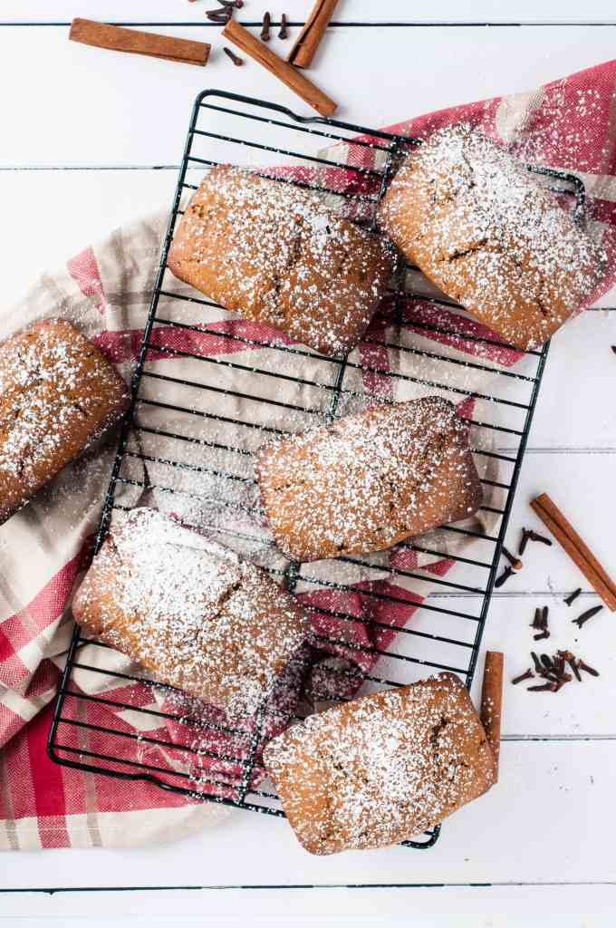 mini gingerbread loaves sprinkled with powdered sugar