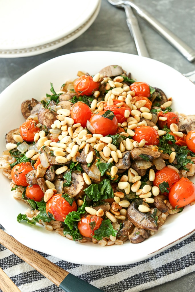 The finished recipe showing toasted pine nuts and tomatoes