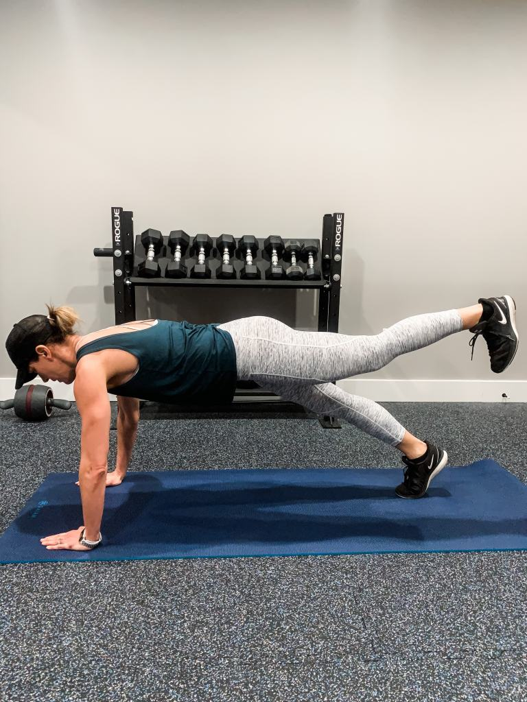demonstrating plank leg lift