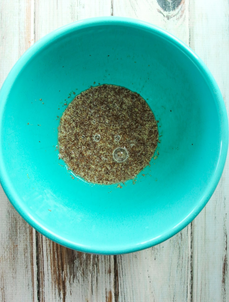 ground flaxseed meal mixed with water in a turquoise bowl