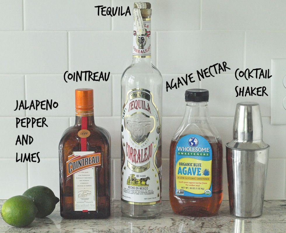 Spicy Jalapeño Margarita Ingredients Picture--showing limes, cointreau, tequila, agave nectar, and a cocktail shaker