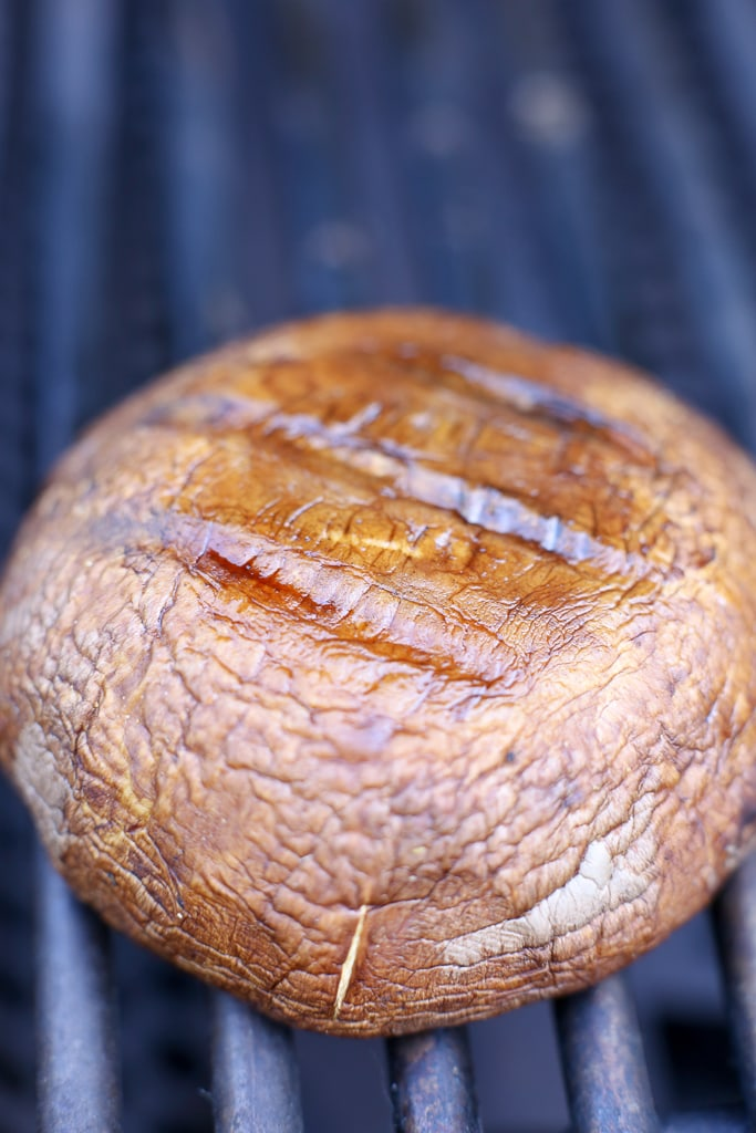 a grill with a portobello mushroom cap with grill marks