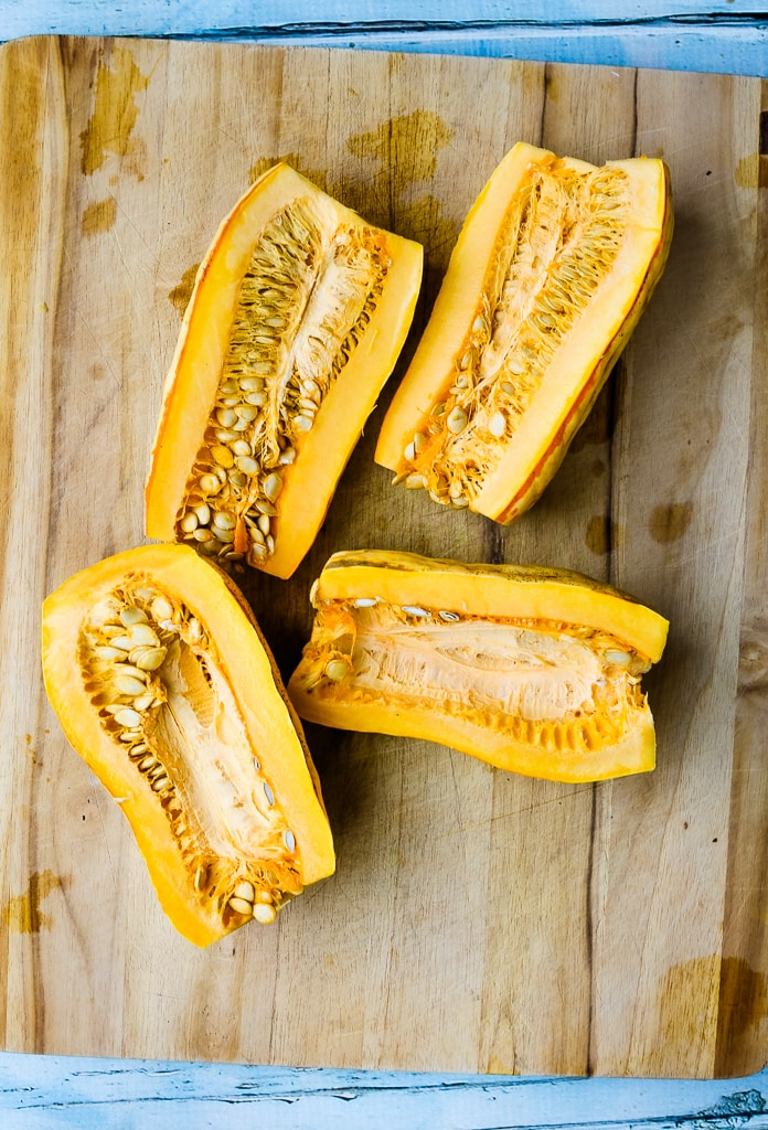 two delicata squashes cut in half