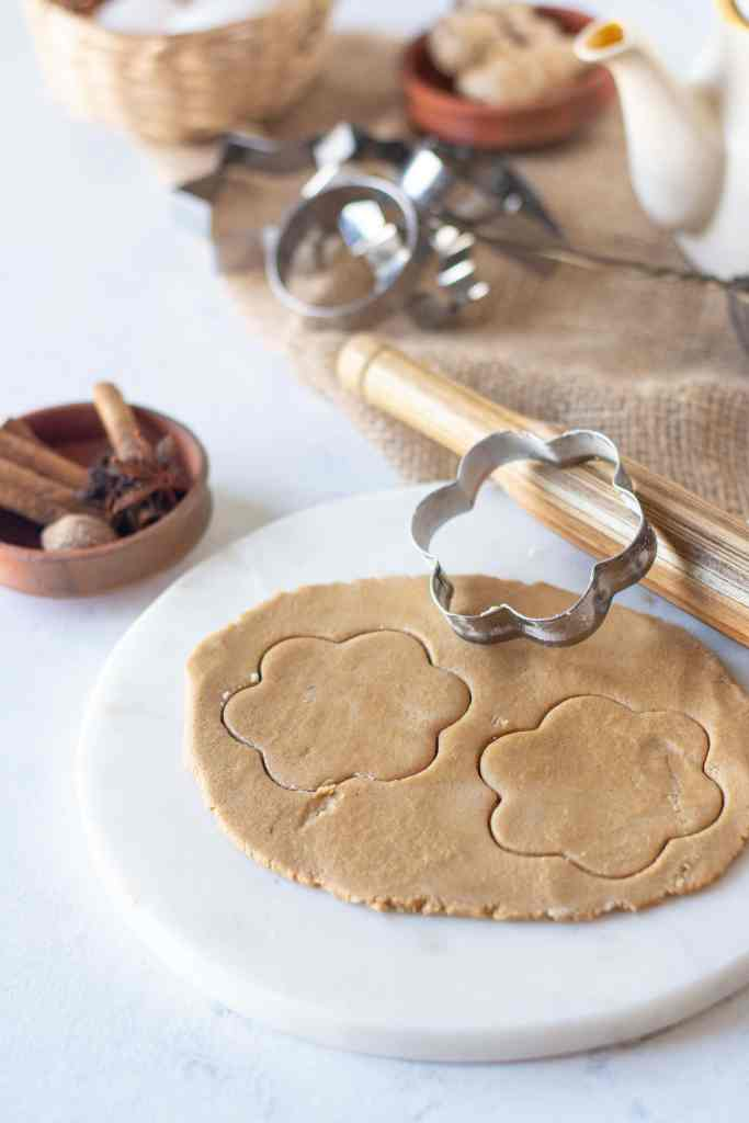 dough flat and a cookie cutter cutting out the shape