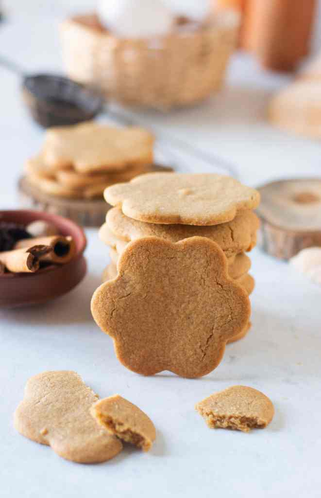 a stack of gingerbread cookies with one leaning on the stack