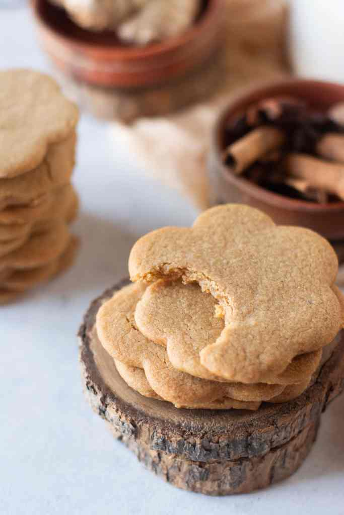 a stack of gingerbread cookies with a bite out of the top cookie
