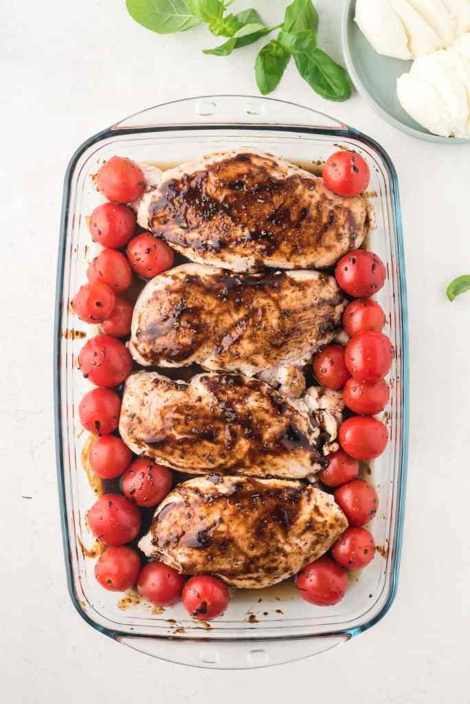 pan of caprese chicken before baking