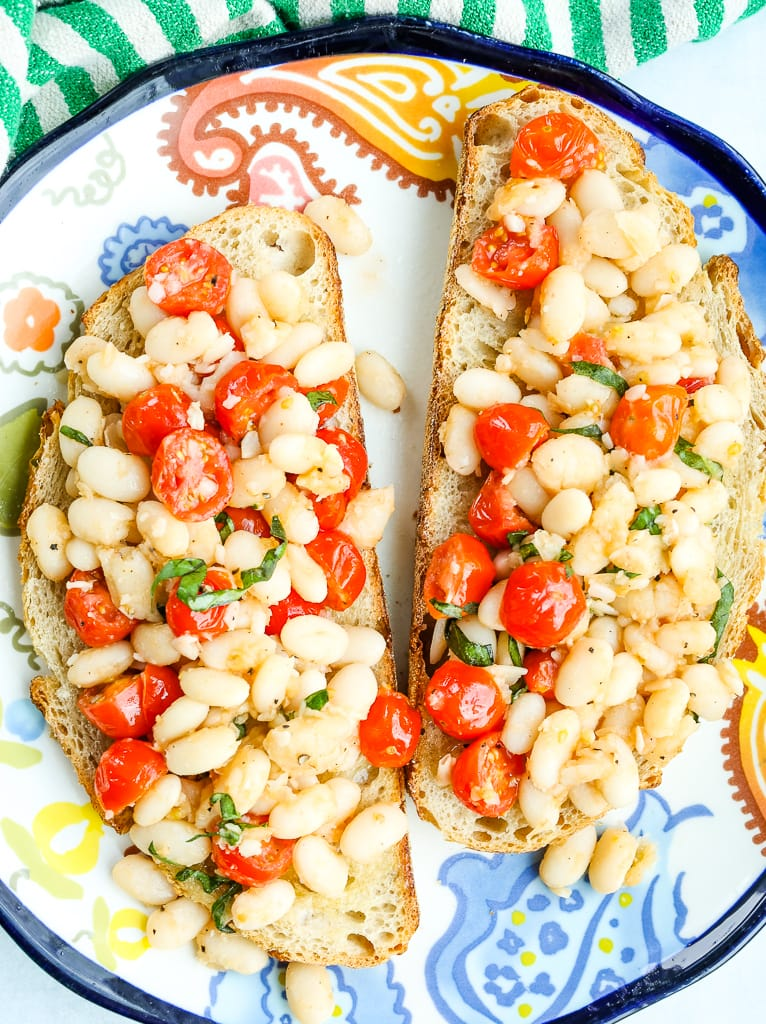 White Beans with Tomatoes and Fresh Basil on toast