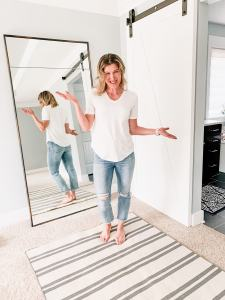 a woman in jeans and the perfect white tee