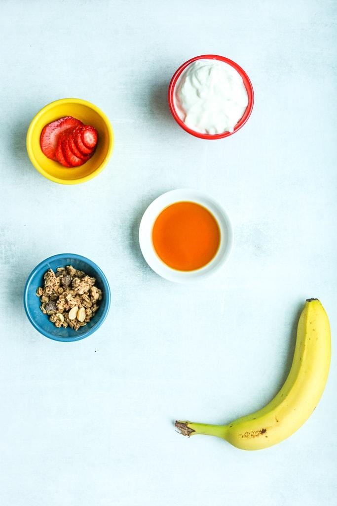 Ingredients for healthy banana split breakfast bowl