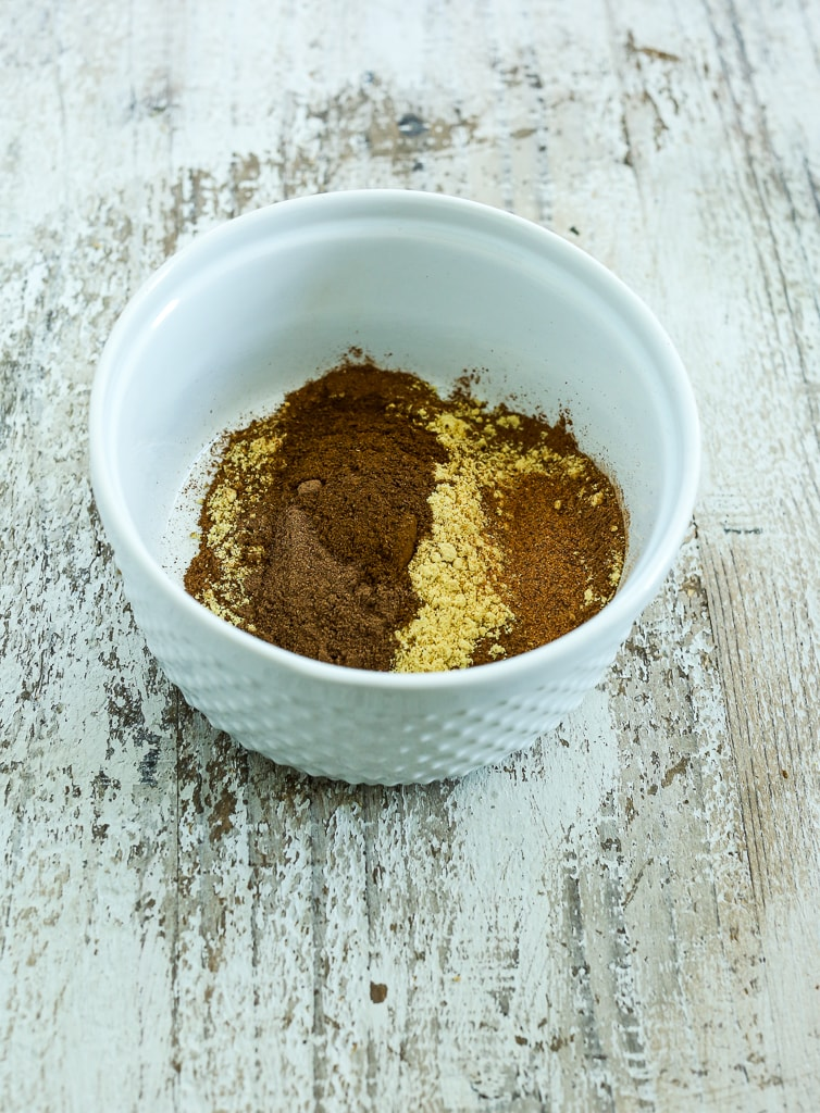 ingredients for Homemade Pumpkin Pie Spice Recipe in a white bowl